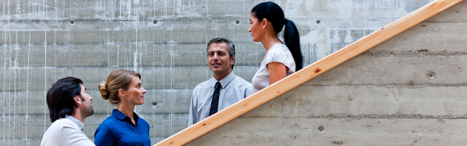 conference-men-women-talking-stairs-1600×500