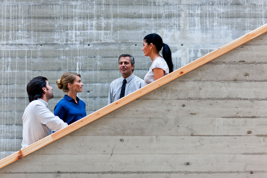 conference-men-women-talking-stairs-900×600